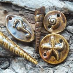 Seashell ,starfish ,seahorse and sand dollar pendants links cab